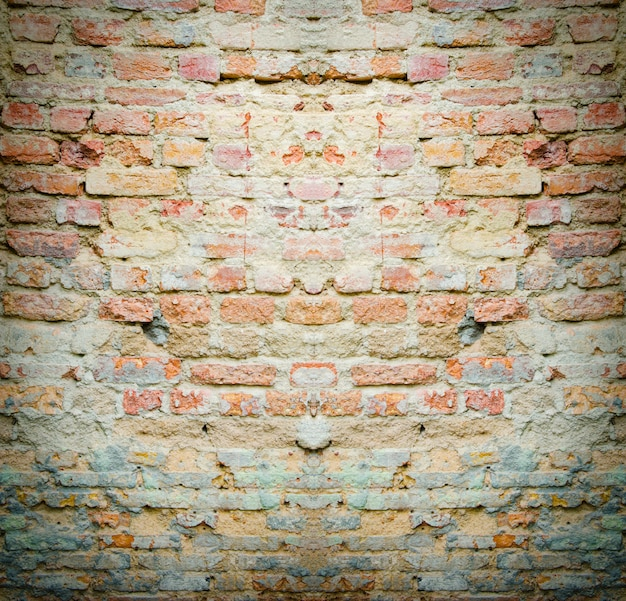 Red brick wall texture grunge background with vignetted corners of interior