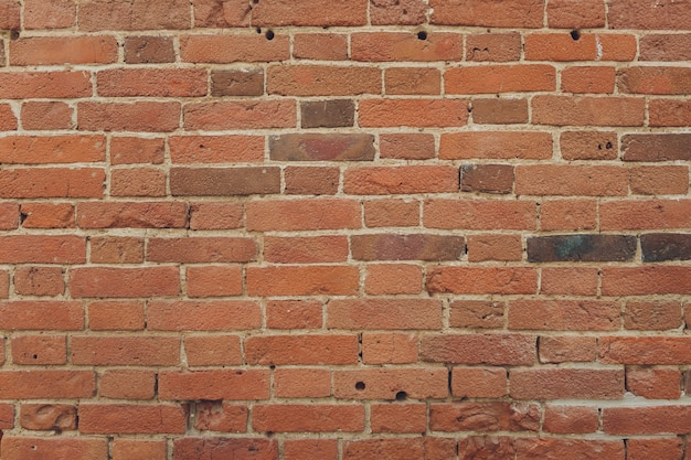 Red brick wall texture grunge wall with vignetted corners, may use to interior design.