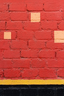 Red brick wall with yellow spots