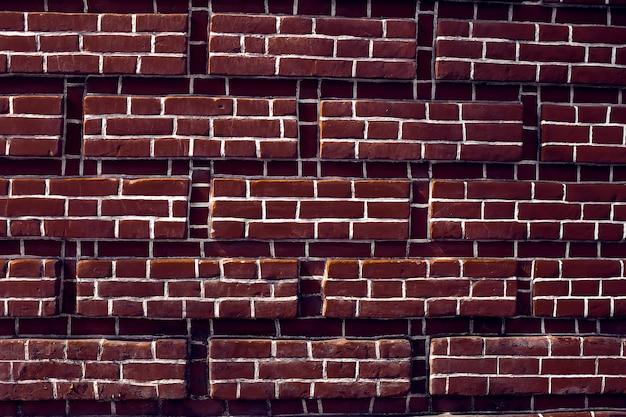 赤レンガの壁の背景のヴィンテージとモダンな質感