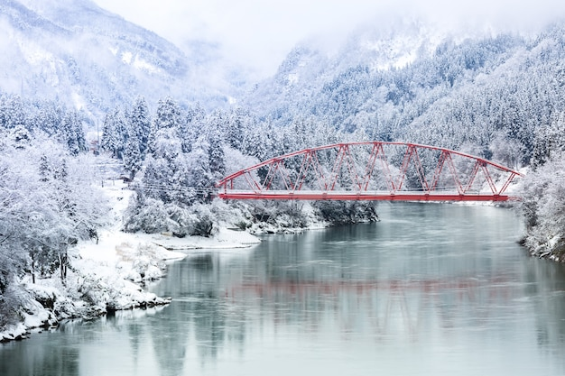 Red bridge winter landscape