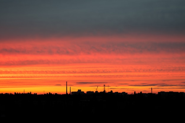 Red bright sunset over the city. city industrial landscape