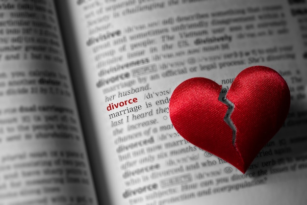 Red broken heart on dictionary divorce definition. the concept of divorce