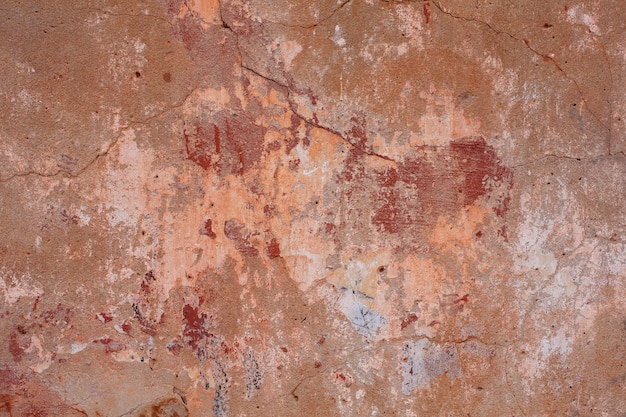Red-brown wall with cracks