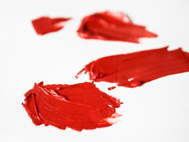 Red brush strokes on canvas