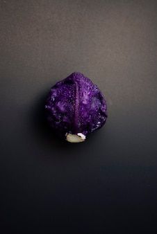 Red cabbage flat lay on dark grunge texture background foodstill life with dark moody photography