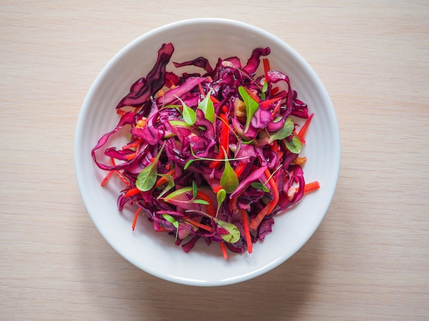 Red cabbage salad with apples and pecan nuts for christmas dinner. vegetarian dish.