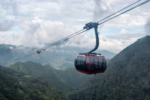 Red cable car sightseeing sapa village in valley