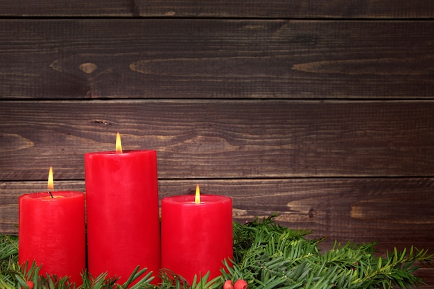 Red candles on wood