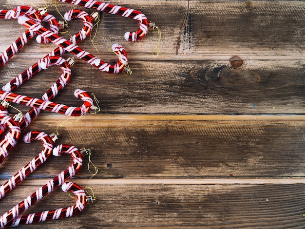 Red candy canes on wooden table