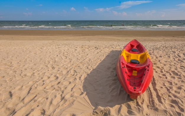 Red canoe on the beach