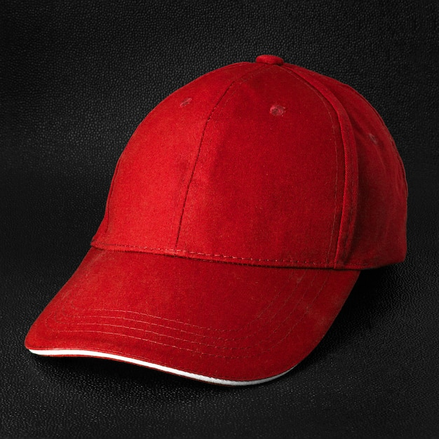 Red cap dark background. template of baseball cap in side view.