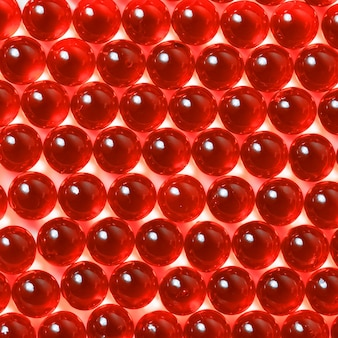 Red capsules on a white background close-up.