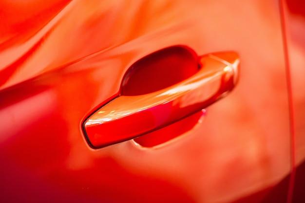 Red car door handle using wallpaper or background