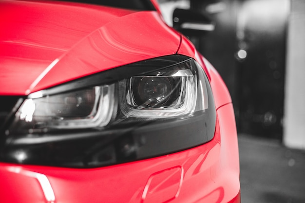 Red car headlight in close up