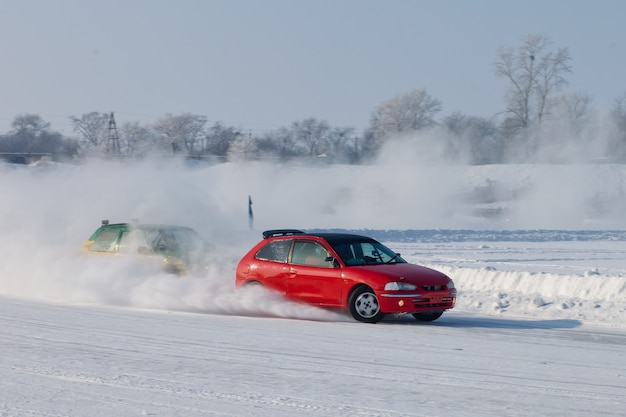 Red car moving on ice with blured background