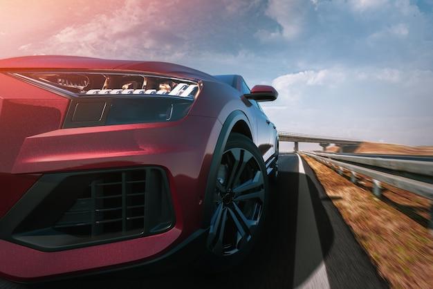 道路を走る赤い車。3dレンダリングとイラスト。