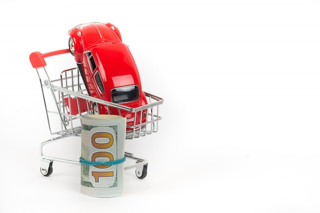 Red car in shopping trolley with money