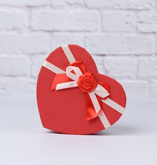 Red cardboard box in the shape of a heart