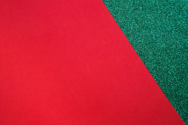 Red cardboard paper on green surface