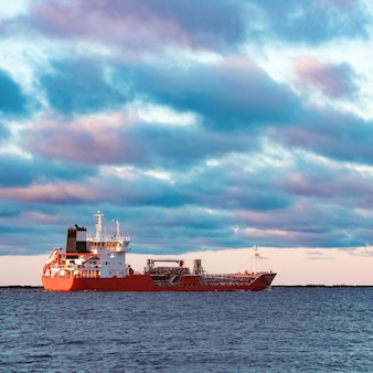 Red cargo oil tanker moving to baltic sea