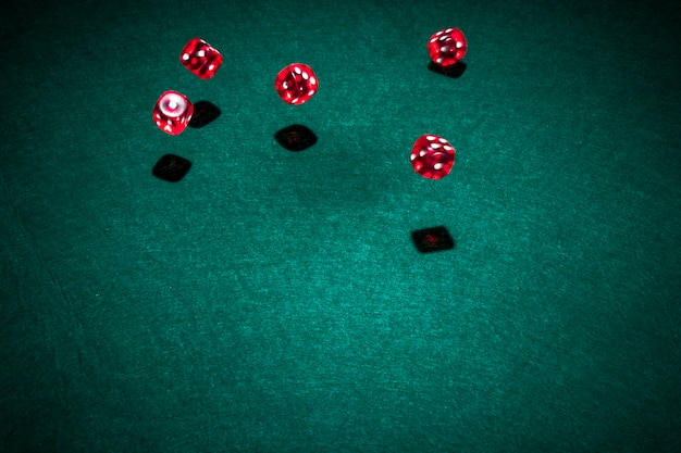 Red casino dice over the poker table