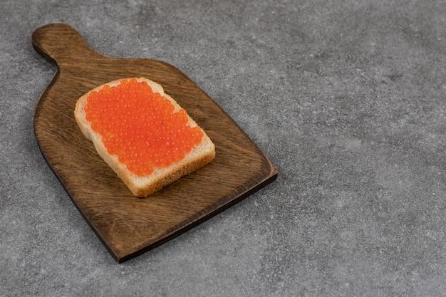 Red caviar on bread slice.. fresh sandwich