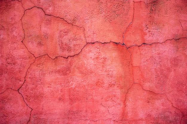 赤いセメントのテクスチャ、壁のコンクリート表面、色付きの背景