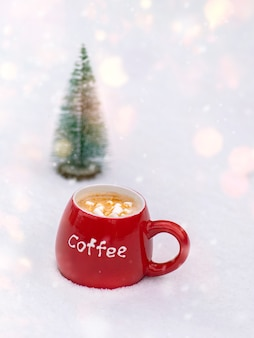 Red ceramic mug with coffee and marshmallows