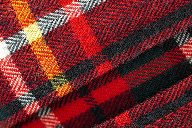 赤い市松模様、生地の布織物と綿素材のタータン高解像度テクスチャ背景、クローズアップ写真