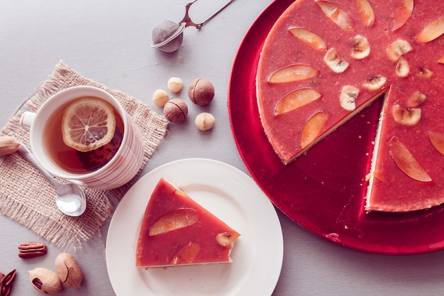 Red cheesecake with tea