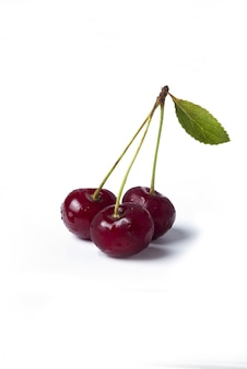 Red cherries isolated on white background
