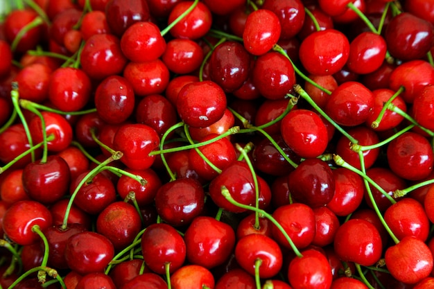 Red cherries with green stems, top view