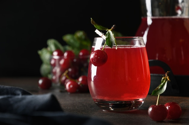 Red cherry freshness homemade compote in glass