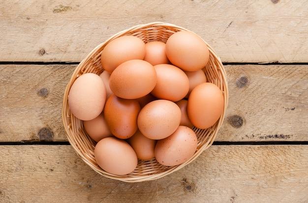 Red chicken eggs in a basket