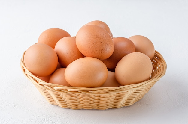 Red chicken eggs in a basket