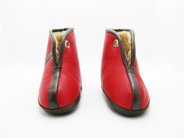 Red children's boots with white background isolation