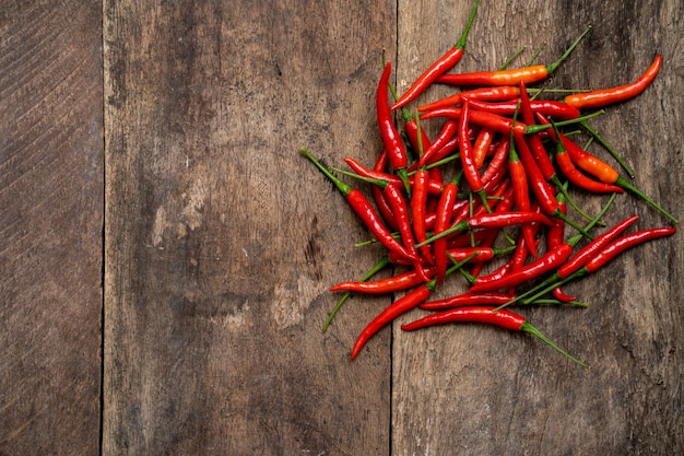 Red chili pepper on old wooden table background