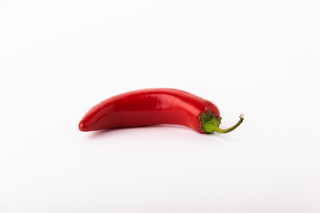 Red chili pepper on white