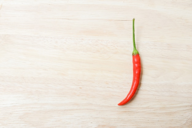 Red chili pepper over wood