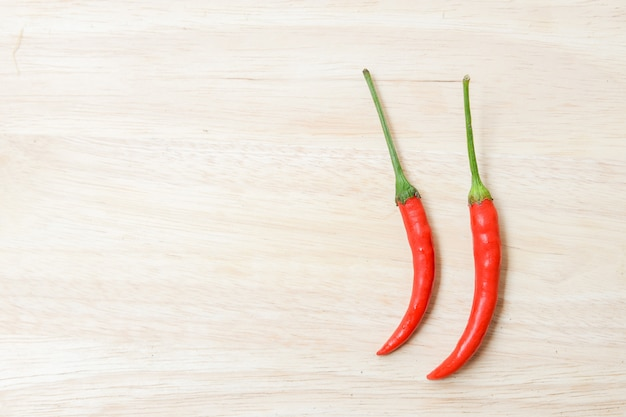 Red chili pepper on wood