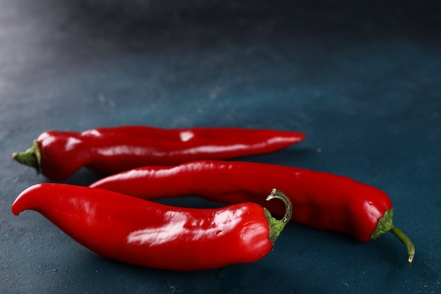 Red chili peppers on the blue background.