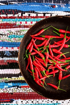 Red chili peppers on striped background