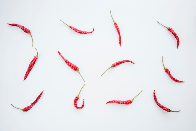 Red chilies arranged on white background