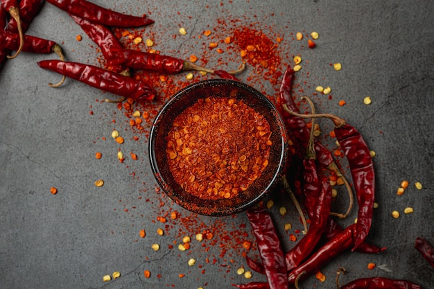 Red chilli paste on black.