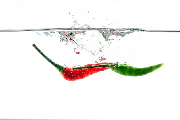 Red chilli, water splashes, solated on white
