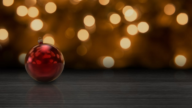 Red christmas ball on a table, with lights background. ideal for christmas and new years greetings cards.