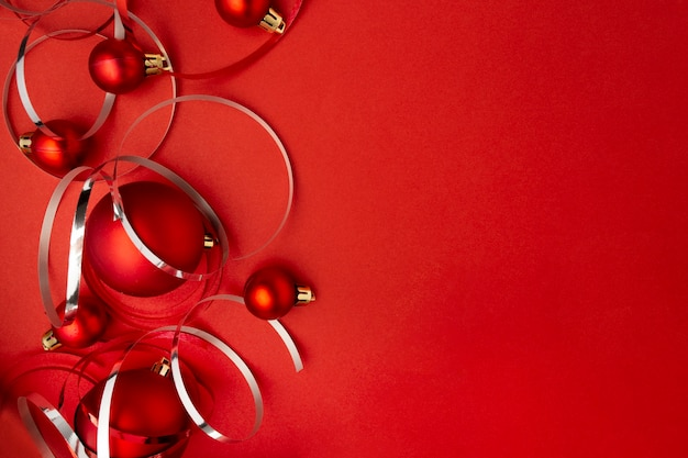 Red christmas balls on red table