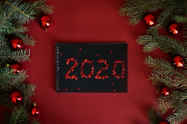 Red christmas baubles decoration. new year 2020 greeting card. minimal style. flat lay.