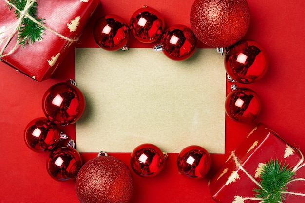 Red christmas baubles with blank page mock up for greeting card